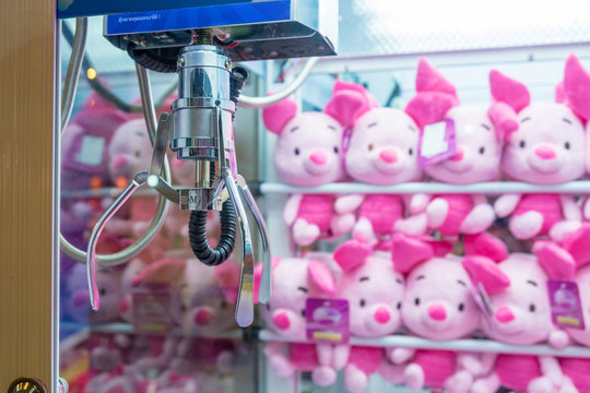 BANGKOK, THAILAND - August 22: Central Ladprao Shopping Center on August 22,2018 in Bangkok, Thailand. Many Colorful dolls Put in the cabinet Claw Game wait for people play catching.