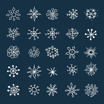 Set of hand drawn sketch snowflakes.