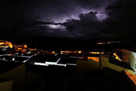 Lightnings illuminate the sky above Ronda as a heavy storm hits towns of the province of Malaga