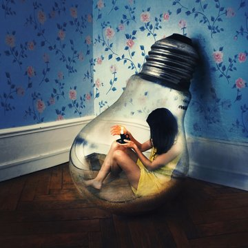 Digitally generated image of woman sitting in light bulb