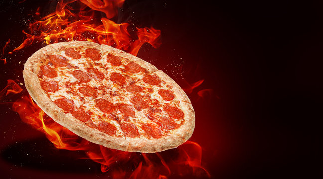 hot fresh traditional italian pizza in flames