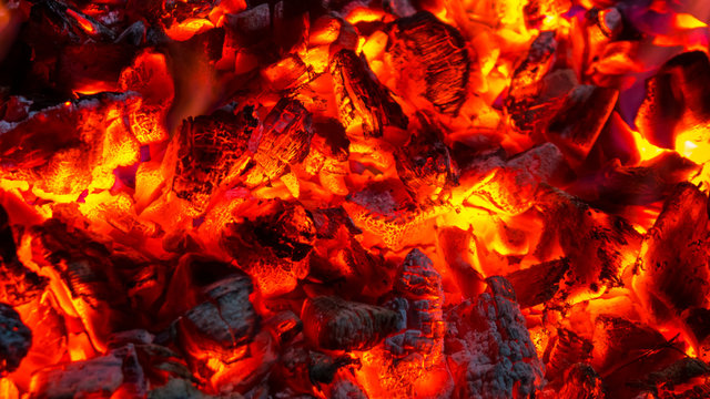 Background of burning hot coals, actively smoldering embers of fire