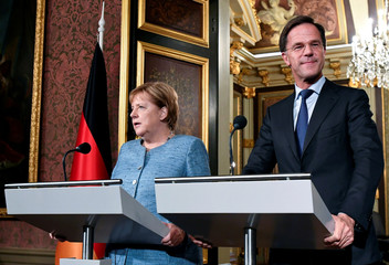 German Chancellor Merkel and Dutch PM Rutte hold a news conference in The Hague