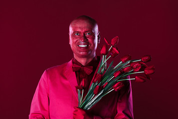 red man with a bouquet of flowers
