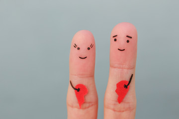 Fingers art of happy couple. Woman and man holding broken heart. Concept of joy after divorce.