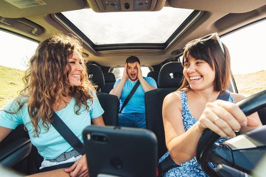 friends in car. road trip