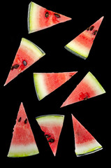 Watermelon slices cut into triangles. White background.