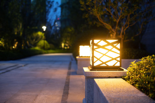 Street decoration and lighting. Warm and romantic atmosphere of evening.