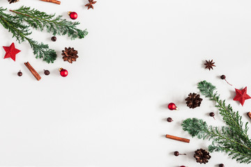Christmas composition. Christmas decorations. fir tree branches. pine cones on pastel gray background. Flat lay, top view, copy space