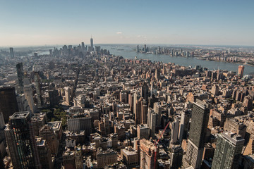 Aerial view of New York City - USA. Manhattan downtown skyline and skyscrapers from the Empire State Building in the morning.