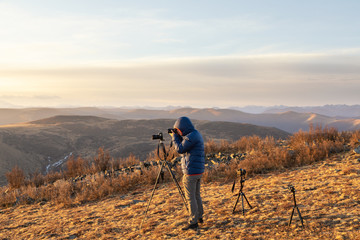 photographer talking photo on mountain