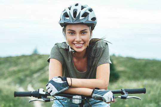 Mountain biking - woman with fatbike enjoys summer vacation. Close up