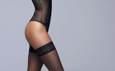 Female body in underwear. Young brunette woman in lingerie.
