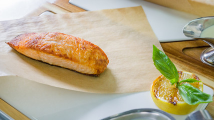 Grilled salmon steak with caviar sauce before serving