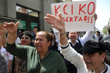 Supporters protest outside the prefecture where Keiko Fujimori is detained in Lima