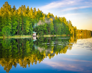 Tampere Finland lake reflections on water with little house on the water, beautiful sky with many colors and trees