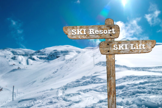 Directions on the signpost to the ski resort and the ski lift.