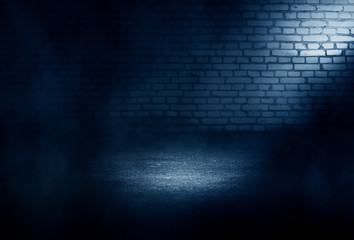 Background of empty dark room with concrete floor. Empty brick walls, neon light, smoke.
