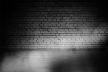 Background of empty dark room with concrete floor. Empty brick walls, neon light, smoke.