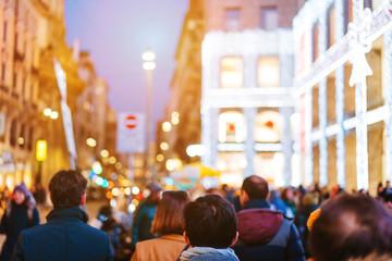 people crowd walking on busy street
