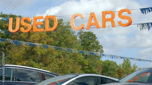 Used Cars A Sign And Streamers For A Used Car Dealership In A