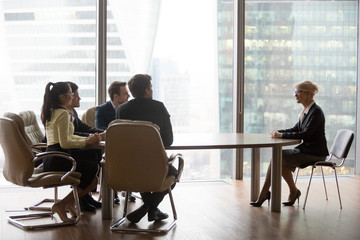 Confident middle-aged female job applicant make good first impression at interview with millennial recruiter, young HR managers satisfied with mature woman candidate at work hiring. Employment concept