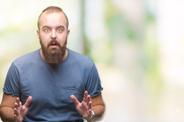 Young caucasian hipster man over isolated background afraid and shocked with surprise expression, fear and excited face.