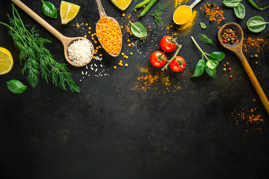 Ingredients for cooking placed on black background.
