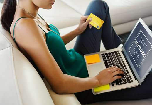 Laptop User with Credit Card Mockup