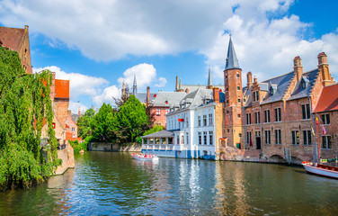 Beautiful canal and traditional houses in the old town of Bruges (Brugge), Belgium
