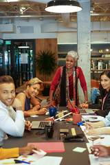 Senior businesswoman in office meeting with colleagues