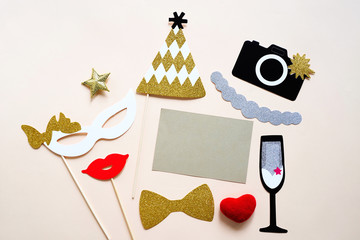 Cute party props and blank card on colorful background, happy new year party celebration and holiday concept
