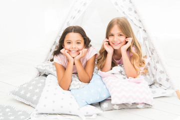 ce157ad2b5 Girls having fun tipi house. Girlish leisure. Sisters share gossips having  fun at home. Pajamas party for kids. Cozy place tipi house. Sisters or best  ...