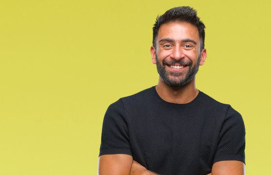 Adult hispanic man over isolated background happy face smiling with crossed arms looking at the camera. Positive person.