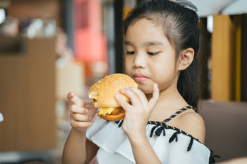 asian Children eat chicken cheese Hamburger Food Court