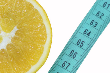 Grapefruit and slimming tape on a white background, a symbol of weight loss and diet
