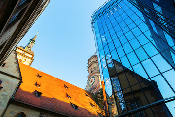 Stiftskirche with reflections in a glass facade in Stuttgart, Germany
