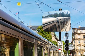 traffic mirror reflects a tram in Strasbourg, France