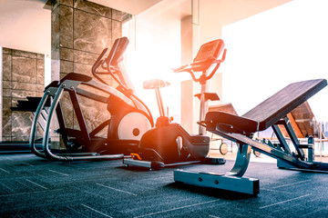 Luxury fitness room with new model of fitness machine in the morning