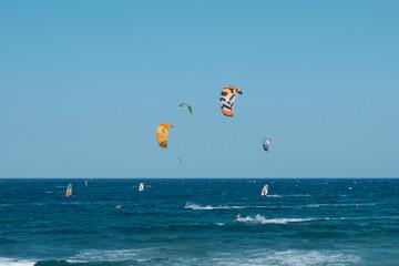 kitesurfer and windsurfer on ocean at El Medano Beach