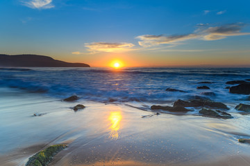 Sunrise Seascape with a smattering of Clouds
