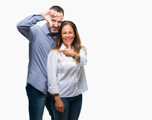 Middle age hispanic business couple over isolated background smiling making frame with hands and fingers with happy face. Creativity and photography concept.