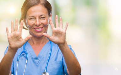 Middle age senior nurse doctor woman over isolated background showing and pointing up with fingers number ten while smiling confident and happy.