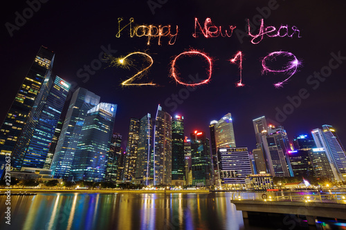 2019 happy new year firework sparkle with central business district building of singapore at night
