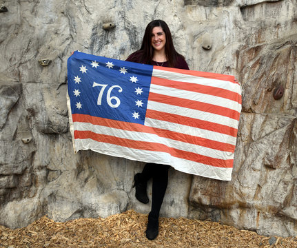 Pretty girl with American 76 Flag
