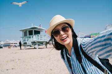 traveler joyfully taking selfie with the seagull