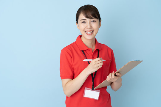 portrait of young asian woman wearing red polo shirts on blue background