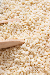 Heap of sesame seeds on wooden boards