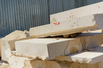 Huge travertine blocks. Untreated travertine in production. Rough rock texture