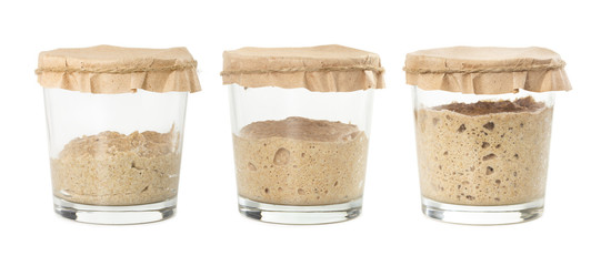 Process of fermentation of homemade rye bread sourdough isolated on white background.